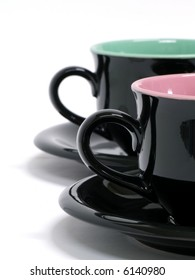 Two black coffee cups on white
