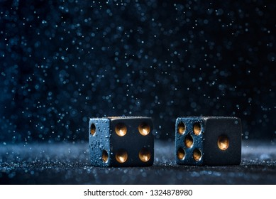 Two black dices on a blue background. The concept of gambling.
