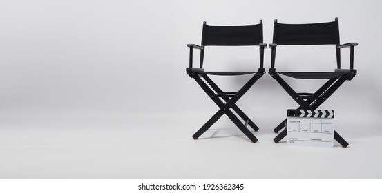 Two black director chair and clapper board use in video production or movie and cinema industry on white background.