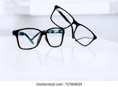 Two black eyeglasses