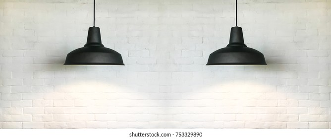 Two black fixtures of lamp have white bricks wall is background for interior design.
