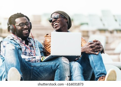 Two black race friends having fun with laptop. Friends Concept