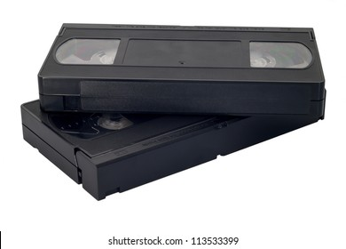 Two black videocassettes on a white background it is isolated.