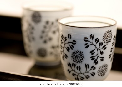 two black and white cups