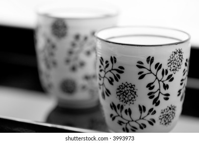 two black and white cups on a black tray