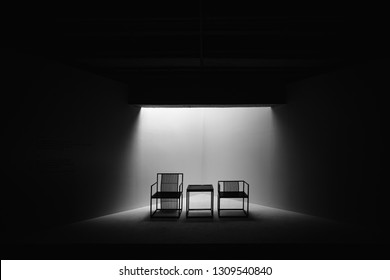 Two Black and White Dramatic Chairs Seating Meeting Decision Important Together Small Table Spotlight Empty Nobody