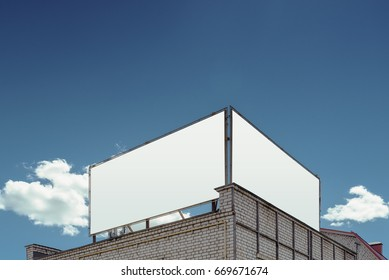 two blank Billboard on the background of cloudy sky
