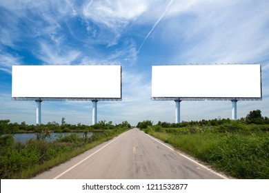 Two blank billboard on the sideway in the park. image for copy space, advertisement, text and object. white billboard in natural green. Blank billboard ready for new advertisement.