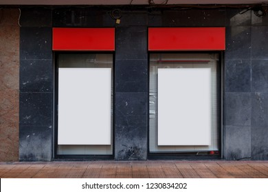 Two blank billboards in a bank office
