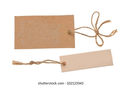 two blank cardboard paper labels or tag with strings isolated on the white background