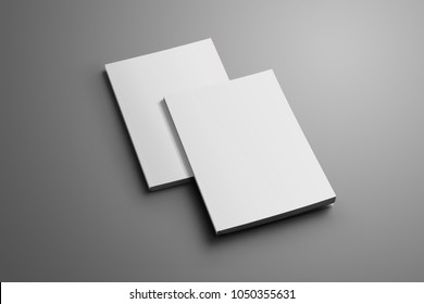 Two blank closed A4, (A5) brochures with soft shadows isolated on gray background. One of the brochures lies of the second brochure. Template can be used for your showcase.