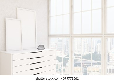 Two blank frames on white chest of drawers, white wall, window to the right. Concept of decoration. Mock up. 3D rendering