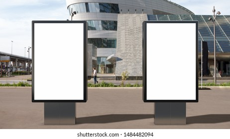 Two blank street billboard poster stand mock up on city business district background.