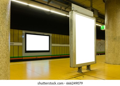 Two Blank Subway Advertisements in Brightly Colored Space Urban Environment