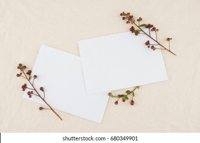 Two blank white cards decorated with budding flowers of crape myrtle