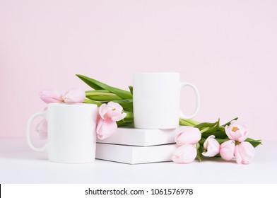 two blank white coffee mug mock ups