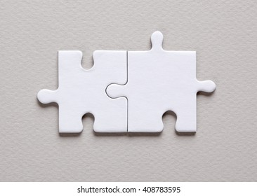 Two blank white puzzle pieces