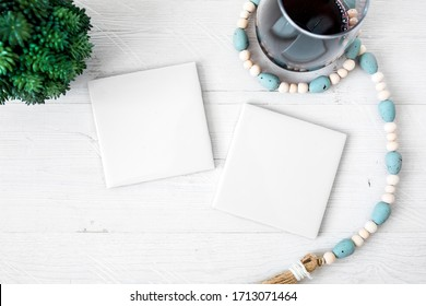 Two blank white tile coasters on white background with wine glass, square coasters mockup