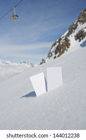 Two blank winter sport ski pass tickets with mountain cable car and scenic background. Concept to illustrate wWinter sport admission fee