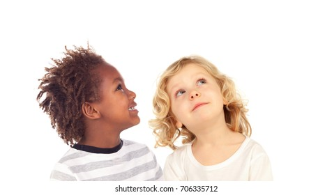 Two blond children looking up isolated on a white backround