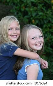 two blond sisters having fun