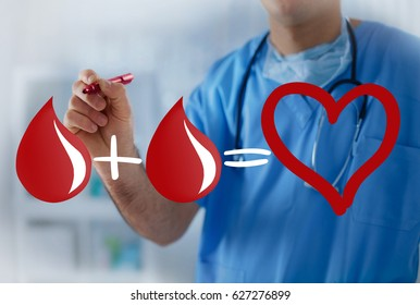 Two blood drops equals healthy heart, blood transfusion concept with doctor in the background