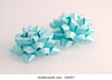 two blue bows with glitter