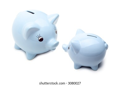 Two blue china piggy banks talking together, one big, one small. Concepts of father advising son, starting young with savings, financial advise, discussing best deal in town.