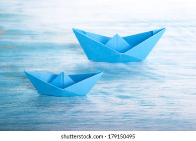 Two blue Origami Boats in the Sea, Nautical Background