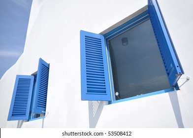 two blue window on the white wall