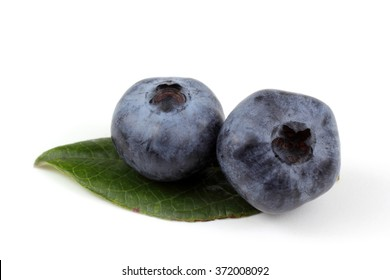 Two blueberries on leaf