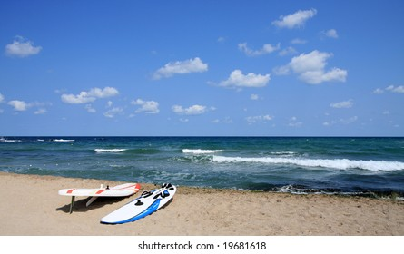 Two board for windsurfing on the beach. Black Sea, Bulgaria. Waves and clouds.