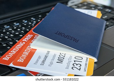 Two boarding pass with a passport on a laptop keyboard. An idea about the convenience for air transportation nowadays can be done easily at hand by using a notebook and the internet.