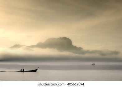 two boats of fisherman in the ocean