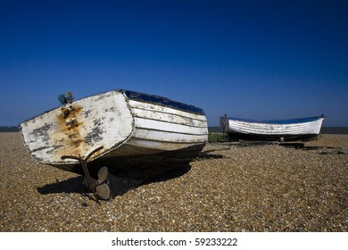Two boats lying on the beach