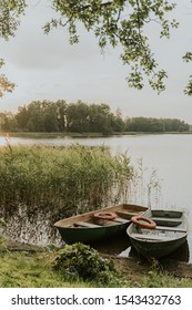 Two boats near the lake