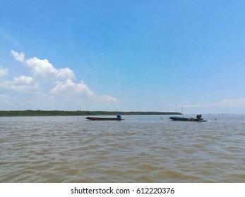 two boats on sea with blue sky and mountrain