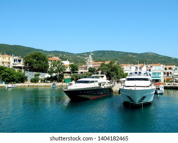 Two boats in the port of Skiathos town on Skiathos Island taken from the Aegean Sea, Greece