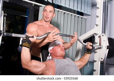 Two Bodybuilders training in the gym