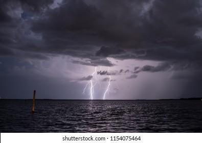 Two bolts of lightning strike.