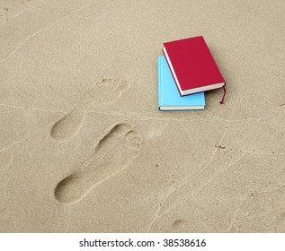 Two books lying beside two footprints.