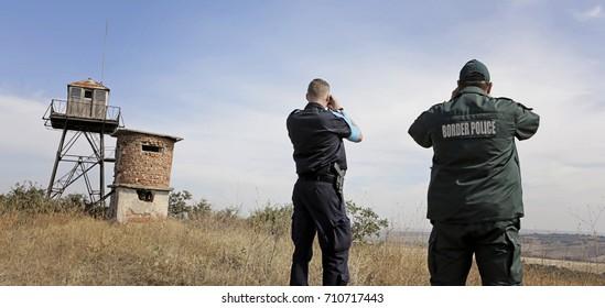 Two border policemen observe border