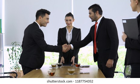 Two bosses meet and sign the contract for dealing between two Company to work together.