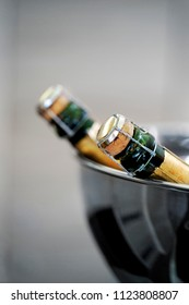 Two bottles of Champagne in a silvery bucket