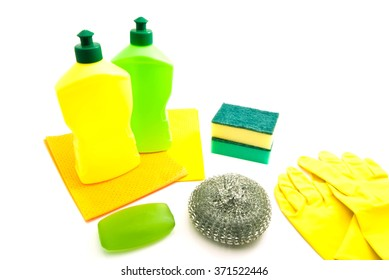 two bottles, rags, soap and gloves on white background