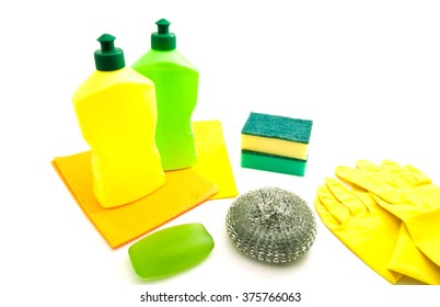 two bottles, rags, soap and gloves on white
