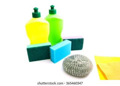 two bottles, rags and sponges on white