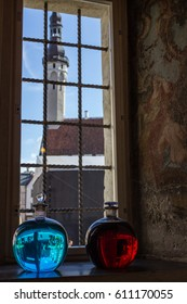 Two bottles with red and blue liquid on the window sill of the old pharmacy, Tallinn, Estonia
