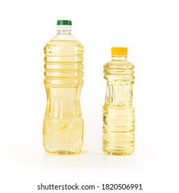 Two bottles of sunflower oil isolated on white background. Yellow sunflower or vegetable oil in a liter and half liter transparent plastic bottles. Full bottle of cooking oil. Studio shot. Front view.
