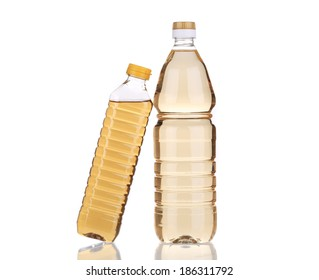 Two bottles of vinegar. Isolated on a white background.